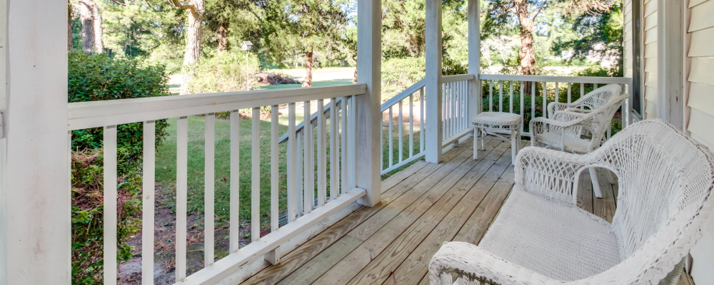 Spend a lazy afternoon on the back porch of The Bell Estate & wedding venue Longs SC